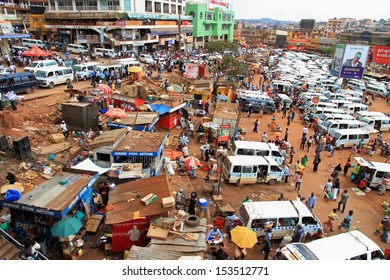 KAMPALA, UGANDA - SEPTEMBER 28, 2012.  People and taxis move about their busy day in the downtown taxi park in Kampala, Uganda on September 28,2012.