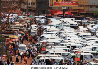 KAMPALA, UGANDA - SEPTEMBER 28, 2012.  Daily life and business moves along in the busy and bustling taxi park of  Kampala, Uganda on September 28,2012.