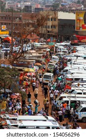 KAMPALA, UGANDA - SEPTEMBER 28, 2012.  People walk through the taxi park going amongst their business in Kampala, Uganda on September 28,2012.