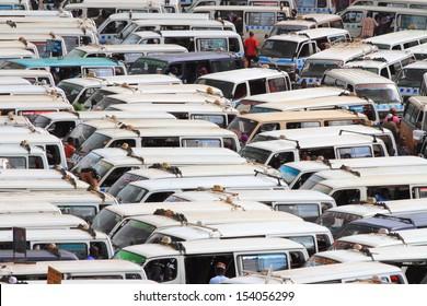 KAMPALA, UGANDA - SEPTEMBER 28, 2012.  Mini buses are packed in bumper to bumper in the taxi park of Kampala, Uganda on September 28,2012.