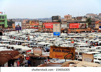 KAMPALA, UGANDA - SEPTEMBER 28, 2012.  Hundreds of minibus taxis wait in the crowded central taxi station in Kampala, Uganda on September 28,2012.