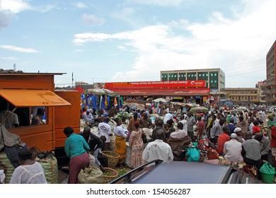 KAMPALA, UGANDA - SEPTEMBER 29, 2012.  Many locals shop at the outdoor food market in downtown Kampala, Uganda on September 29,2012.