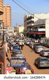 KAMPALA, UGANDA - SEPTEMBER 29 2012.  People go about their everyday business on a street in downtown Kampala, Uganda on September 29,2012.