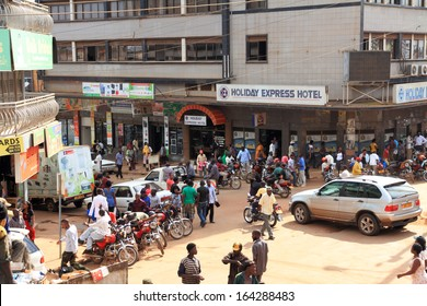 KAMPALA, UGANDA - SEPTEMBER 29 2012.  Many locals go about their business on a street corner in downtown Kampala, Uganda on September 29,2012.