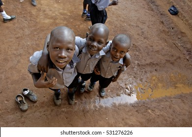 Kampala, Uganda-10 April 2007: Three young schoolfriends are playing outside while they having a brake.