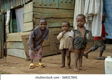 Kampala, Uganda-11 April 2017. Brothers and sister playing in front of their house in Kampala township.