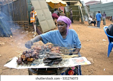 Kampala, Uganda-11 April 2017. The way people life in Uganda. woman cooking meet at a fire place and sell it on the street.