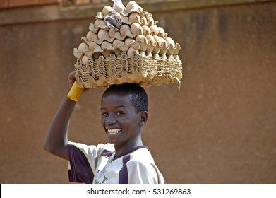 Kampala, Uganda-12 April 2007. The way people life in Uganda. Beautiful smile of boy selling eggs.