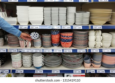 KAMPEM, THE NETHERLANDS - JULY 12, 2016: Tableware in a shop. Shelves filled with crockery in a Dutch Action Superstore.