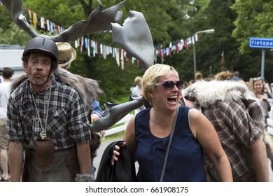 KAMPEN, NETHERLANDS - 17 JUNE 2017. Unknown woman get kisses on her back through human reindeer.