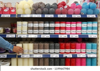 KAMPEN, THE NETHERLANDS - JULY 12, 2016: Aisle with varied colored candles in a Dutch Action superstore.