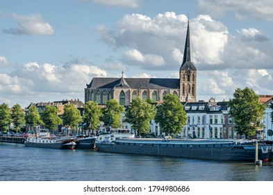 Kampen, The Netherlands, July 26, 2020: Medieval Bovenkerk church towering above the waterfront of the old town and the IJssel river