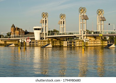 Kampen, The Netherlands, July 30, 2020: the city bridge in the golden hour on a summer evening, reflecting in the river IJssel