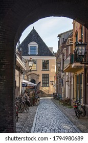 Kampen, The Netherlands, July 30, 2020: looking through the gate underneath the clock tower into the narrow Torenstraat (tower street)