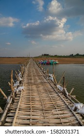KAMPONG CHAM, CAMBODIA, APR 23, 2019: old traditional bamboo wooden bridge across Mekong river (from Koh Paen island to Kampong Cham), Cambodia