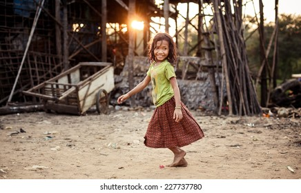 KAMPONG PHLUK,CAMBODIA - JANUARY 01: Portrait of an unidentified Khmer girl on Tonle Sap Lake in Kampong Phluk,Cambodia on 01.2014 January .It is the largest lake in Southeast Asia