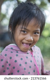 KAMPONG PHLUK,CAMBODIA-APRIL 17:Portrait of an unidentified asian girl on Tonle Sap Lake in Kampong Phluk,Cambodia on April 17, 2014.It is the largest lake in Southeast Asia (up to 16,000 square km).