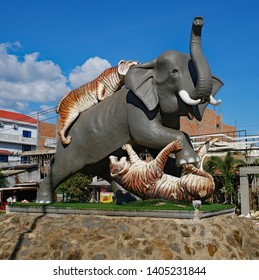 Kampong Thom, Cambodia. 17-12-2018. The Elephant and Tiger monument in Kampong Thom town centre. It is a large sculpture depicting two tigers attacking an elephant. A popular meeting point.