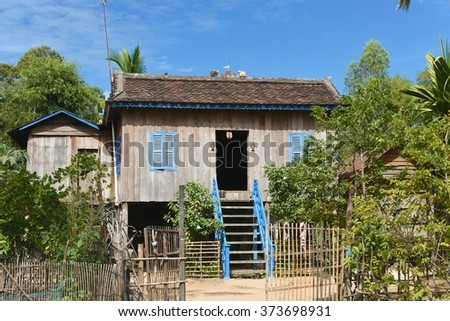KAMPONG THOM, CAMBODIA - DEC 21, 2015: Traditional Cambodian house, close to Sambor Prei Kuk, Kampong Thom (Kompong Thom), Cambodia. These traditional homes are build of wood and on stilts.