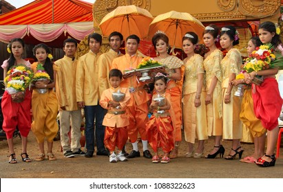 Kampong Tom, Cambodia. 04-10-2014. Wearing beautiful traditional Khmer wedding clothes the bride and groom with their attendants, pause for a photograph prior to the marriage ceremony.