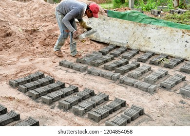 Kampong Tralach; Kingdom of Cambodia - august 21 2018 : builder in the Wat Kampong Tralach Leu pagoda site