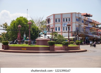 Kampot, Cambodia - 12 Apr 2018: town view with salt worker monument on empty square. Cambodian travel photo. Tourist place sightseeing. Khmer daily routine. Urban landscape with colonial architecture