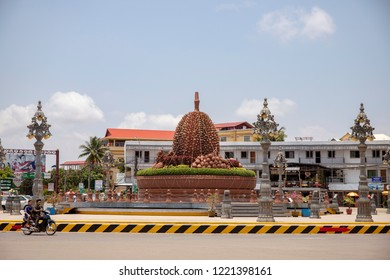 Kampot, Cambodia - 12 April 2018: town view with durian monument on city square. Cambodian travel photo. Tourist place sightseeing. Khmer daily routine. Urban landscape with colonial architecture