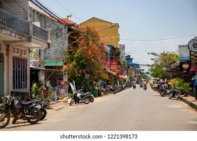 Kampot, Cambodia - 12 April 2018: town view with french colonial buildings and khmer restaurants. Cambodian travel photo. Tourist place sightseeing. Khmer daily routine. Urban landscape with transport