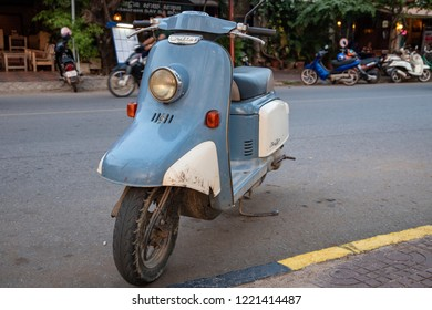 Kampot, Cambodia - 12 April 2018: blue vintage scooter on town street