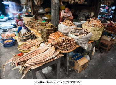Kampot, Cambodia, Asia - January 5, 2016: Cambodian woman sell an abundance of dried fish products at Covered Central Market in Kampot, Cambodia - Asia.