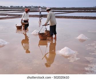 Kampot, Cambodia - Jan 25, 2012. Working on salt field in Kampot, Cambodia. Kampot's economy is based on Salt and Pepper production.
