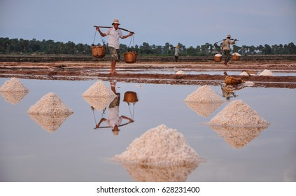 Kampot, Cambodia - Jan 25, 2012. People working on salt field in Kampot, Cambodia. Kampot is known for its high quality pepper, fish sauce and durian.