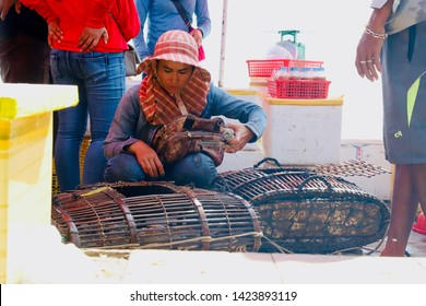 Kampot, Cambodia - May 16th, 2019: Cambodian fishermen harvesting and selling crabs in a local crab market in Kep, Kampot, Cambodia.