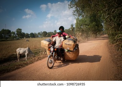 Kampot/Cambodia- 1.12.2016: farmers are coming back from the market on their overcharged motorcycle