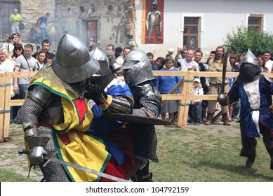 KAMYANETS PODILSKY, UKRAINE - JUNE 2: unidentified knights fight during Forpost (The Outpost) Festival of Medieval Culture on June 2, 2012, Kamyanets Podilsky, Ukraine