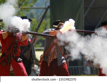 Kamyanets-Podilsky, Ukraine, 10/01/2016. Musketeers and cossacks shooting with muskets. Rifle with fire and sparks. Reenactment of the 17th century battle. Attack of cossacks. Living history. Hobby.