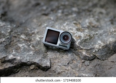 Kamyanets-Podilskyi, Ukraine - July 8, 2019: DJI Osmo Action on stone background. Action camera for photo and 4k video.