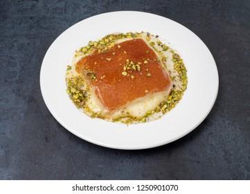 Kanafeh arabic dessert with green almonds
