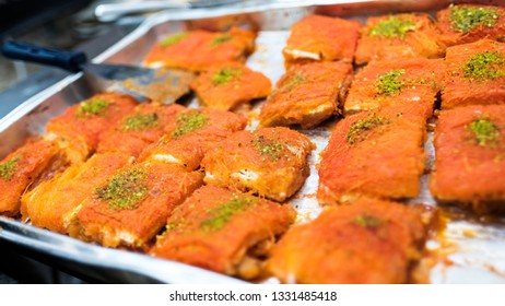 Kanafeh is a Kadaif desert (Middle-Eastern honey cake) made of thin noodle threads with goat cheese, Jerusalem, Israel.