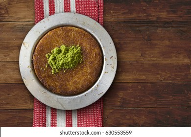 Kanafeh Middle Eastern cheese pastry over table top view
