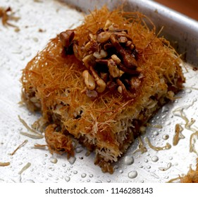 Kanafeh, a Palestinian dessert made with noodle-like pastry and layered with nuts