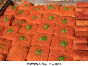 Kanafeh pieces for sale at Mahane Yehuda Market, popular marketplace in Jerusalem, Israel