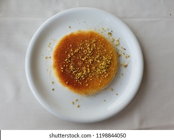 kanafeh traditional middle east Arabic food restaurant dessert on a white dish plate