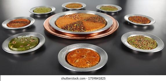 Kanafeh.Turkish dessert kunefe, kunafa, kadayif with pistachio powder and cheese, served hot, very sweet. Turkish traditional dessert Künefe tatlısı, antep fıstıklı