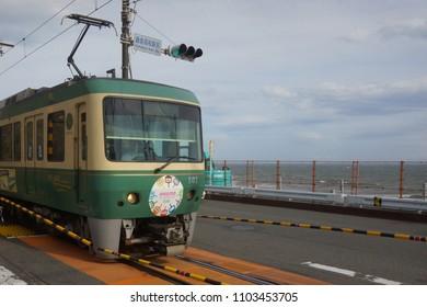 kanagawa, japan, 05 06 2017 : view of train on railway near kamakura high school station, famous spot of slam dunk comics