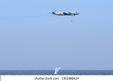 Kanagawa, Japan - October 15, 2015:Japan Maritime Self-Defense Force Lockheed Martin P-3C Orion dropping anti-submarine bomb.