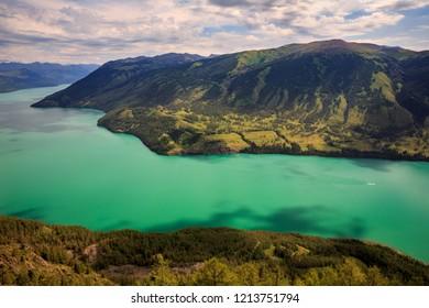 Kanas Lake, Kanas Nature Reserve. Jinqiu Xinjiang Province, China. Alpine forest and fresh glacier water. Altai Mountains, Kazakhstan, Mongolia and Russian border. Northern tip of Xinjiang China