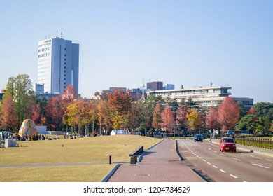 Kanazawa, Ishikawa, Chubu, Japan - November, 5 2017 : Beautiful view of Kanazawa cityscape in autumn season with Japanese people relaxing in a public park of Kanazawa and Colorful leaves in background
