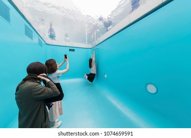 Kanazawa Japan - June 02, 2017 : Unidentified people visit optical illusion swimming pool at 21st Century Museum in Kanazawa.