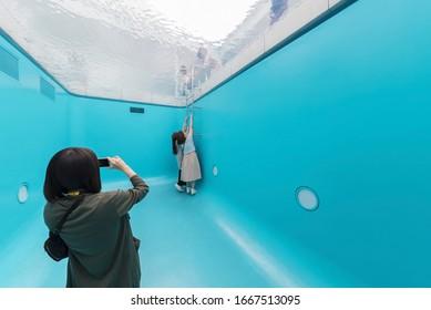 Kanazawa Japan - June 02, 2017 : Unidentified people visit optical illusion swimming pool at 21st Century Museum in Kanazawa, Japan